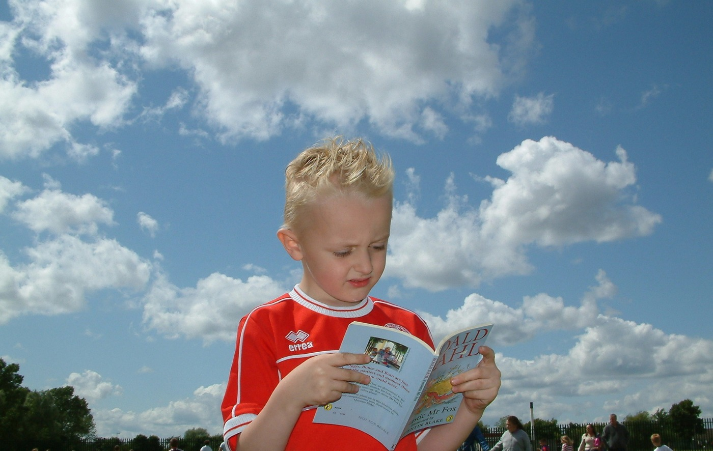 boy makes face while reading