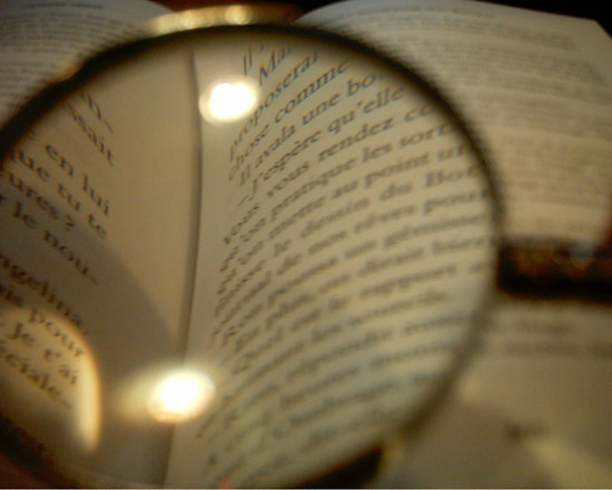 magnifying glass over text for proofreading